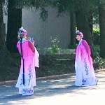 Two women in traditional Japanese outfit.