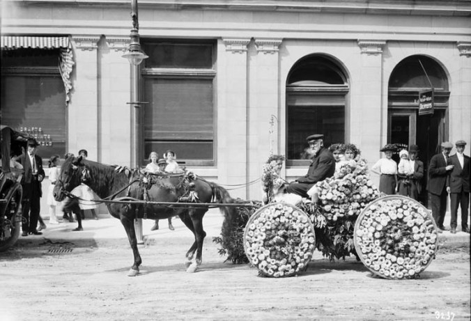 Floral buggy in the Labour Day parade, Front St. (September 1913) William James Topley. Library and Archives Canada, PA-010537 CC BY 2.0