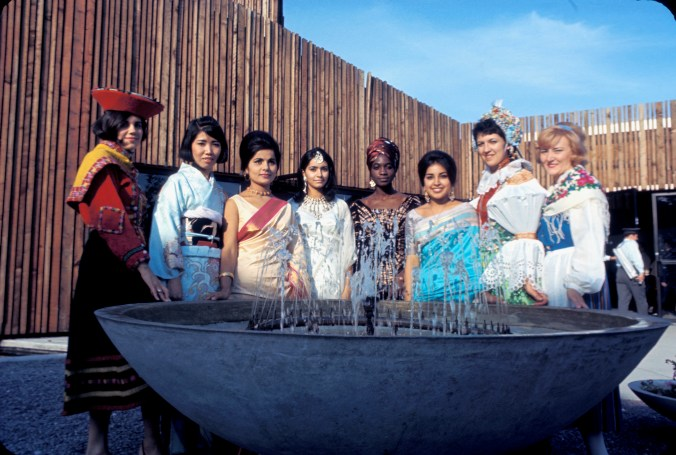 Hostesses from different countries posing for a group photo at Expo 67