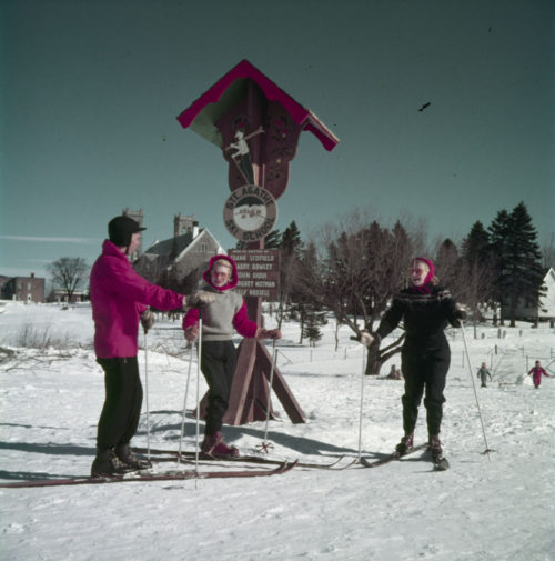 One male and two female skiers in a class at a winter resort in the Laurention mountains of Québec.