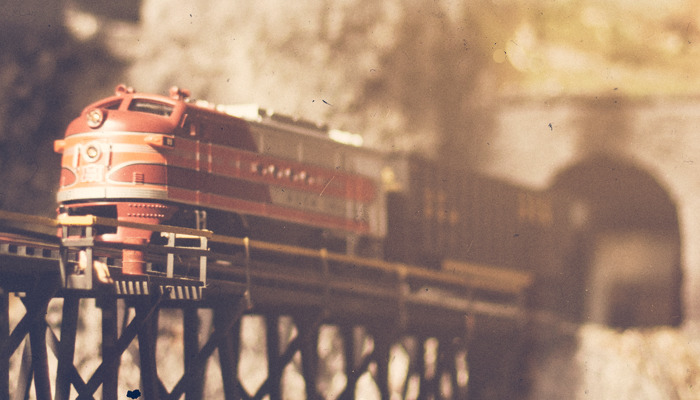 Model train crossing bridge