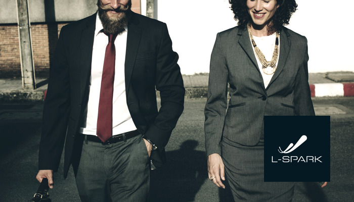Business people outdoors with the L-Spark logo.