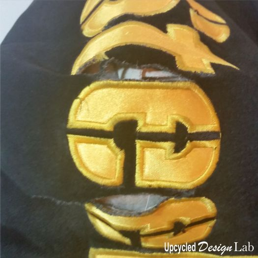 Torn sleeve of Pittsburgh Steeler Coat