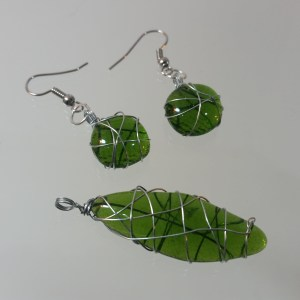 Green fused glass wire wrapped pendant and earring set upcycled from bottle glass