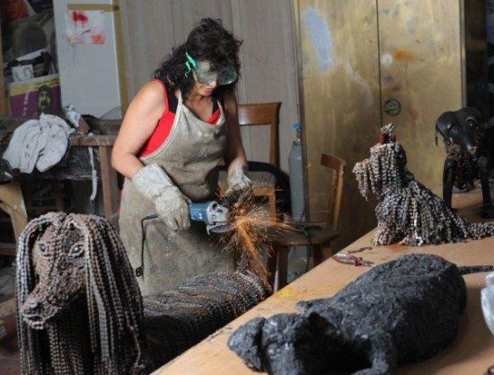 Nirit Levav making dog sculptures