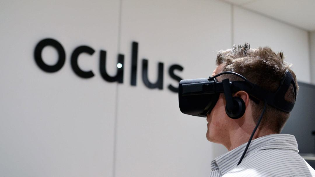 A man wearing an Oculus VR Headset.