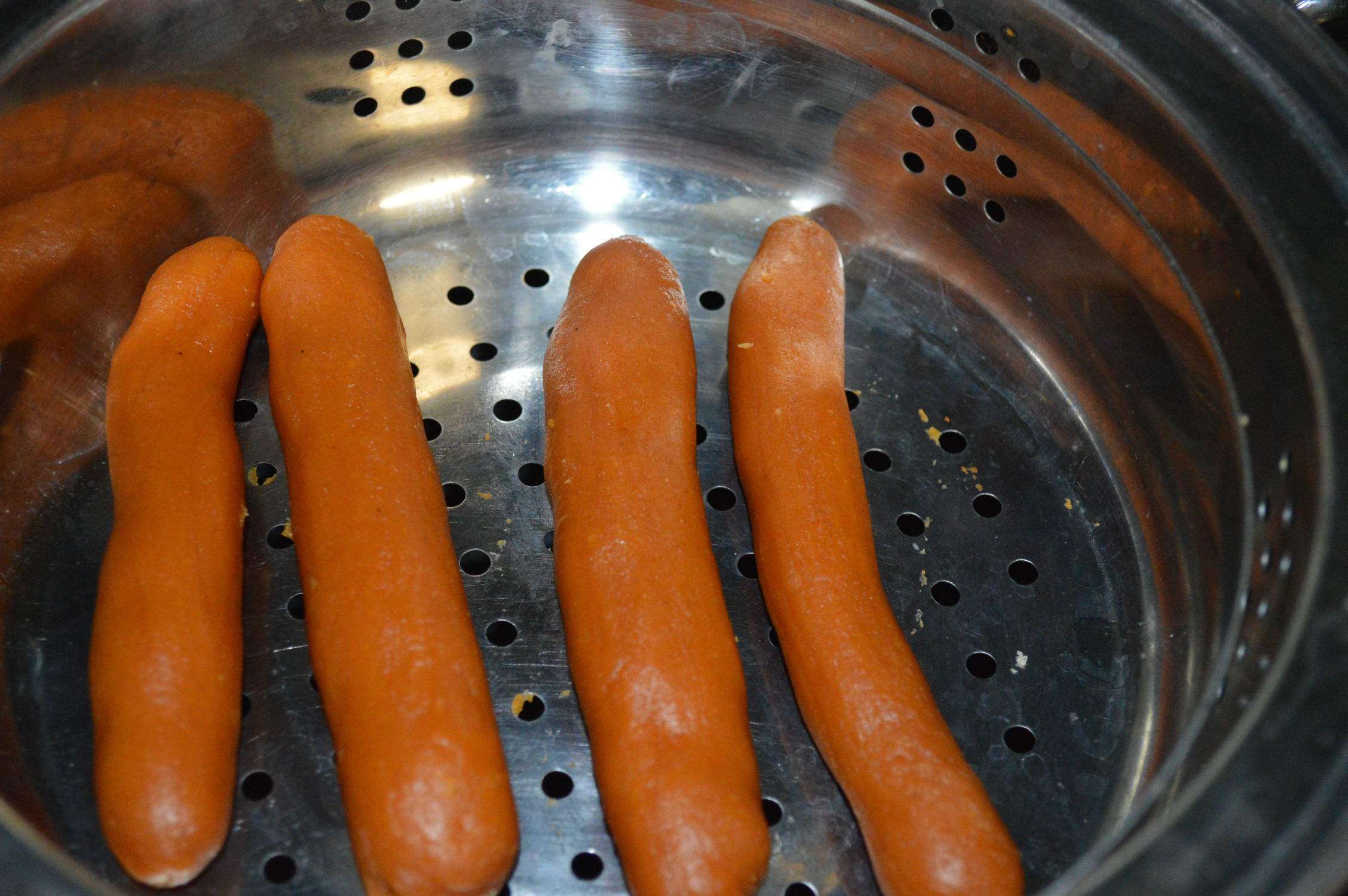 Add hot dog to steamer