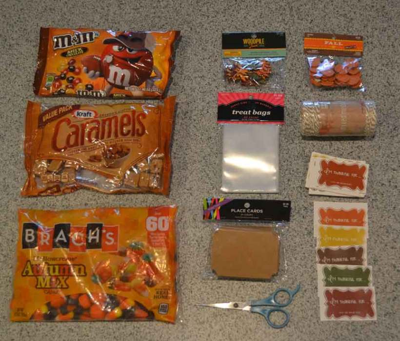 scissors, candy, treat bags, labels