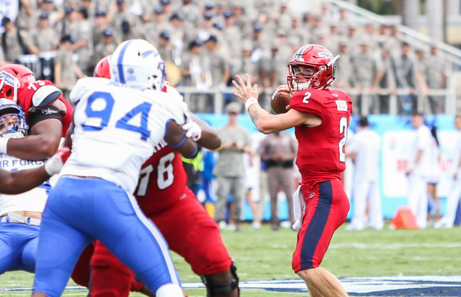 FAU shines in home opener against Air Force     University Press FAU redshirt freshman quarterback Chris Robison  2  decides where to throw  the football before