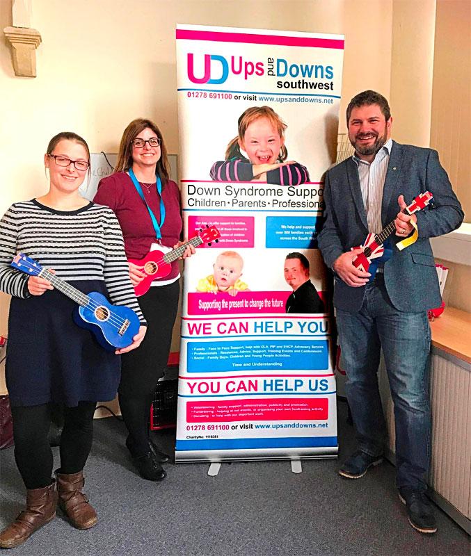 Taunton Round Table gifting Ukuleles and Kazoos to Ups and Downs Southwest