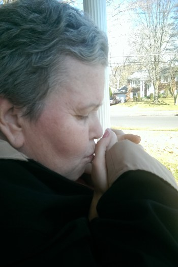 Momma kissing hand crop