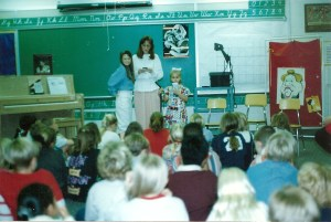 Just a little first grade girl, in a flowered dress, presenting to my elementary school about Down syndrome