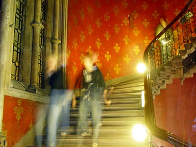 Ghostly walkers down the Grand Stair, Midland Grand, St Pancras, Euston Road, London UK