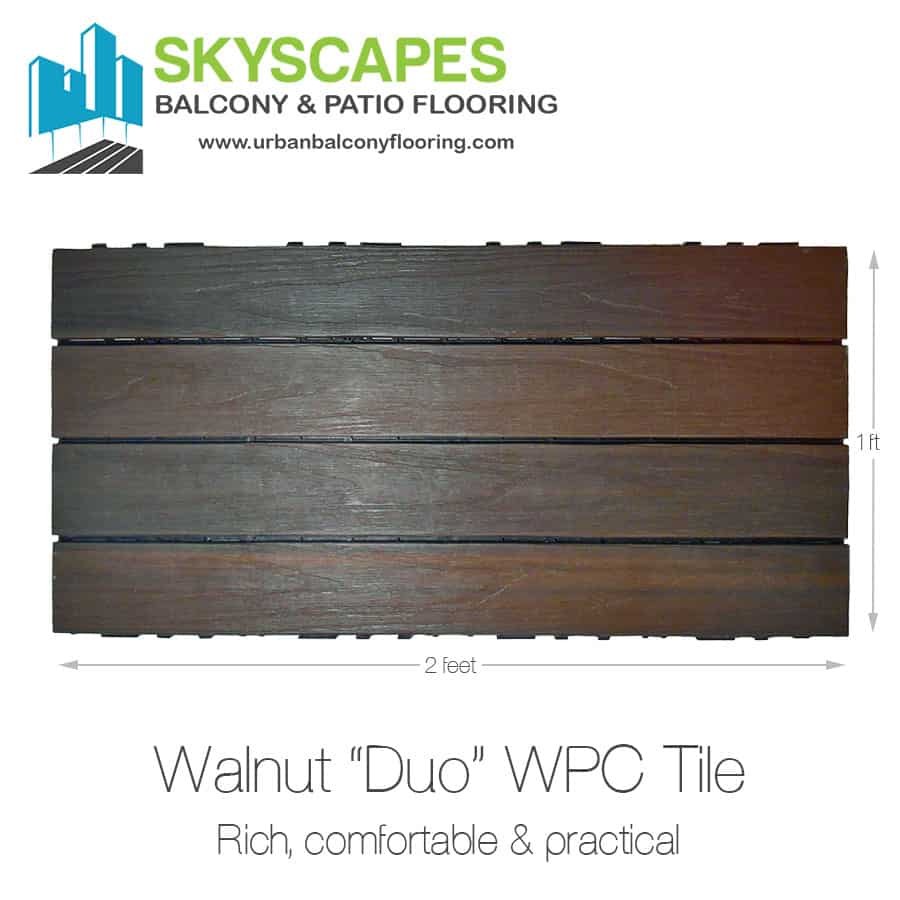 Walnut, 4-slat, wood-grain WPC tile of a rich dark brown colour, seen on face.  Measures 2 by 1 feet.  Skyscapes green and blue logo at top-left of image.