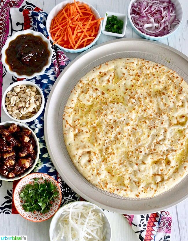 A super yummy, dairy-free, veggie-packed, ginger & garlic peanut sauce CPK Copycat Thai Chicken Pizza recipe on UrbanBlissLife.com