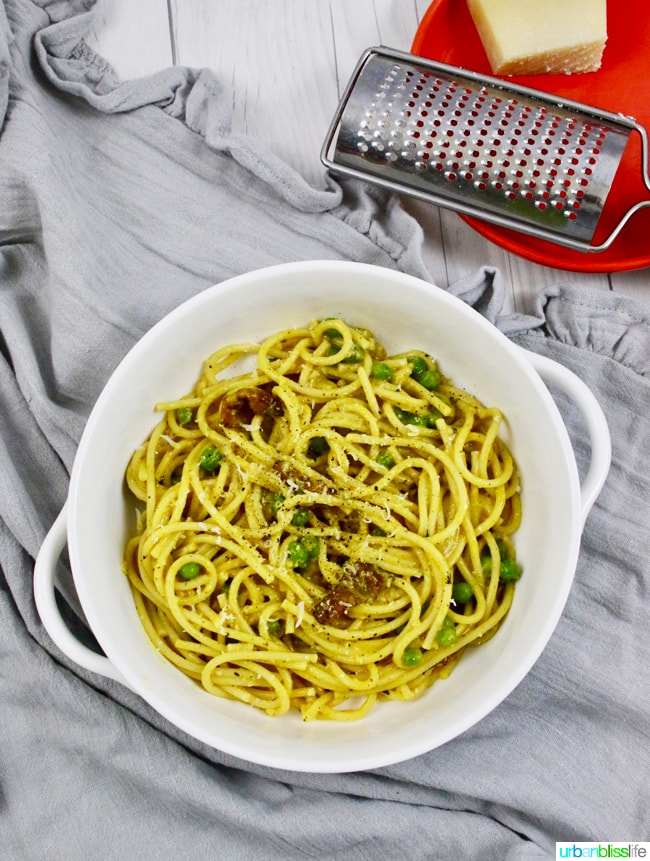 Pasta with Turmeric, Bacon, and Peas is a hearty lunch or dinner dish full of flavor! Recipe on UrbanBlissLife.com