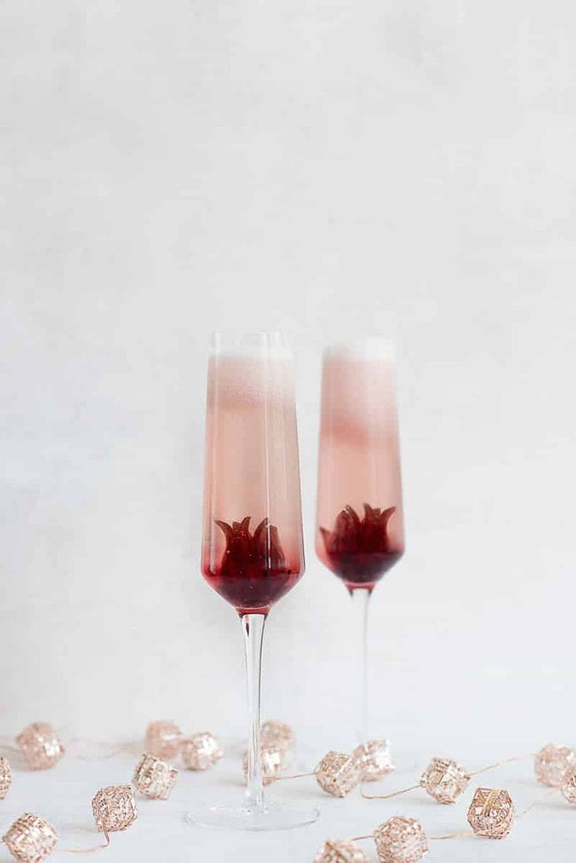 Ombre Prosecco Hibiscus 20 Festive Winter Party Cocktails on UrbanBlissLife.com