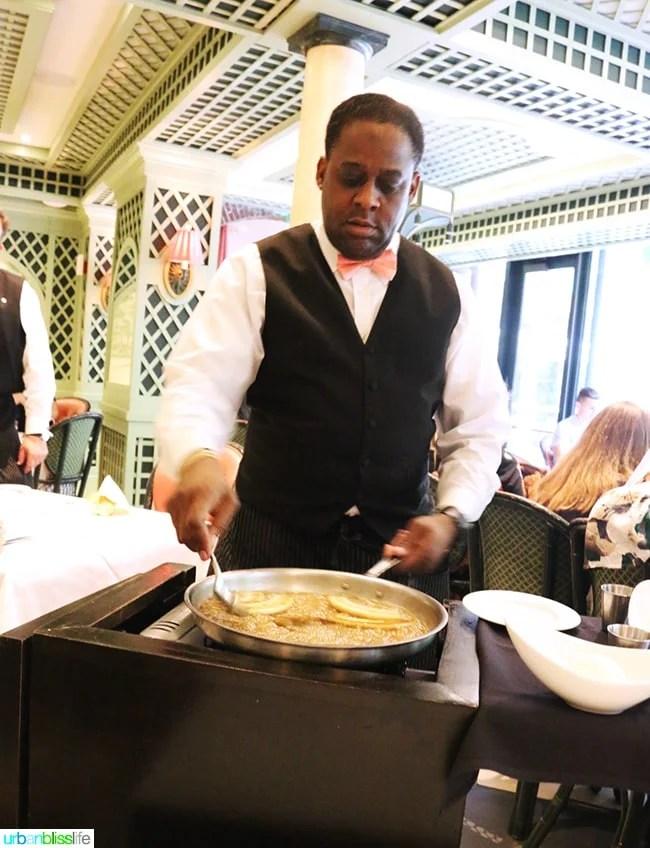 Making bananas foster at Steak Diane at Brennan's Restaurant, travel stories on UrbanBlissLife.com