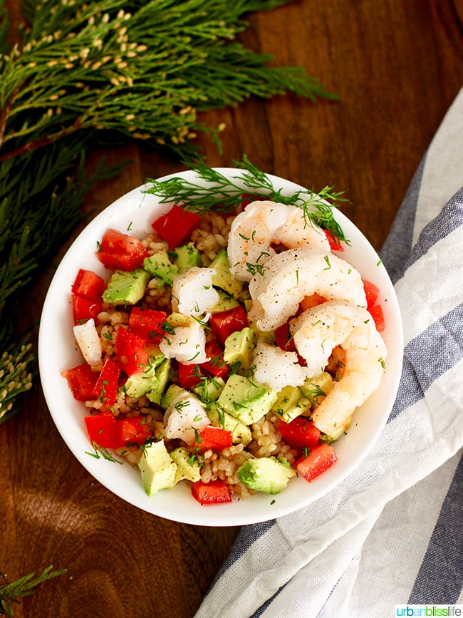 shrimp avocado rice bowl with napkin and leaves