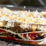 Mexican Lasagna layered in pan