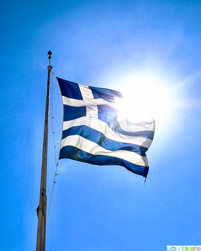 Greek flag with sun shining behind it ©UrbanBlissLife.com all rights reserved