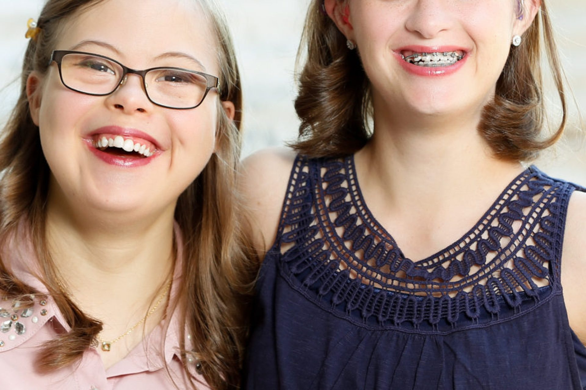 These two friends are apart of a special dance company of individuals with special needs. They have down-syndrome and go out to educate people in the community about how they are just like everybody else, but with an extra chromosome.