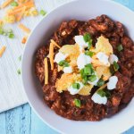 Turkey chili with black beans topped with cornbread bites and cheese