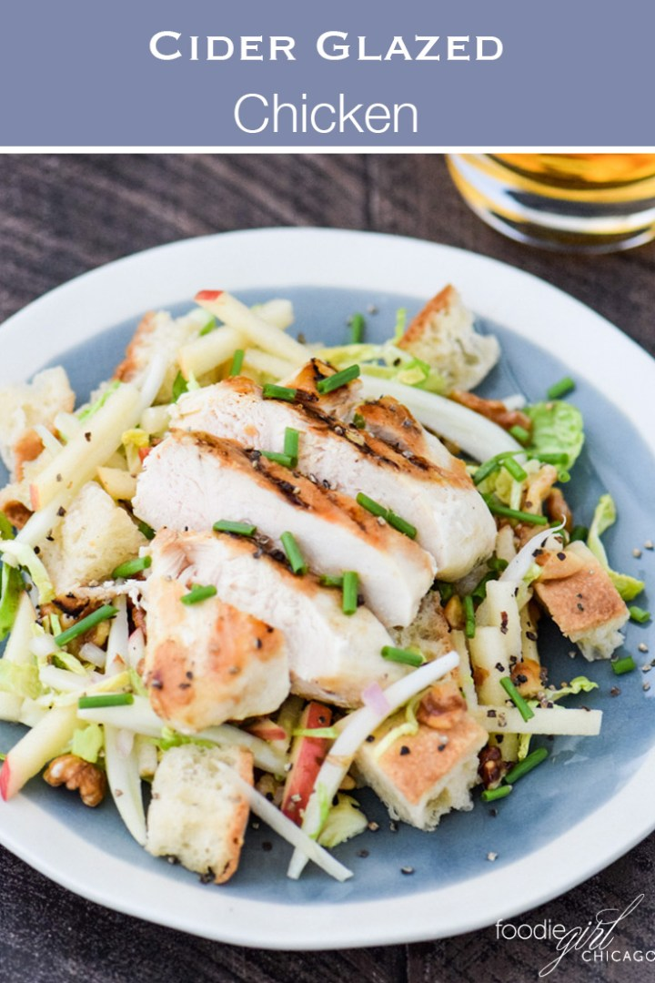 Cider glazed chicken on a bed of panzanella salad on a blue plate