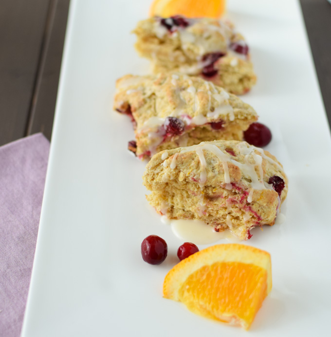 This Cranberry Orange Scone recipe combines tart flavor of cranberries with the bright fresh flavor oranges giving you the dish for a fall brunch party.