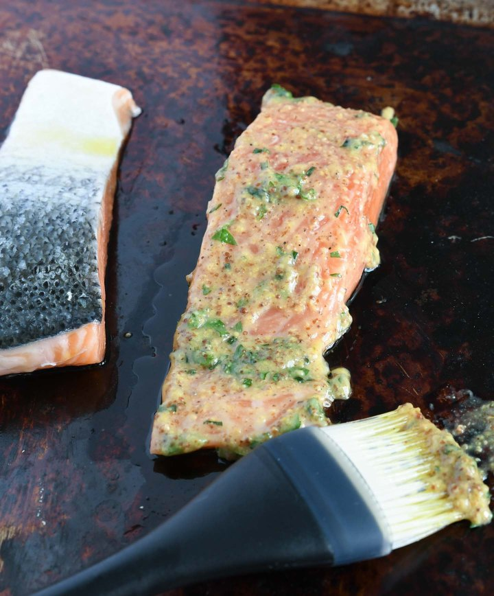 Uncooked salmon brushed with mustard sauce - ready for the grill
