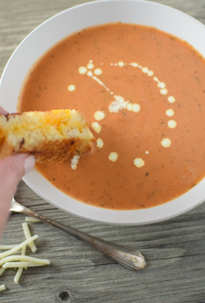 Grilled cheese stick dipped in Tomato Bisque