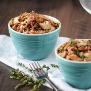 Two bowls of farro topped with chicken, pistachios and pomegranate