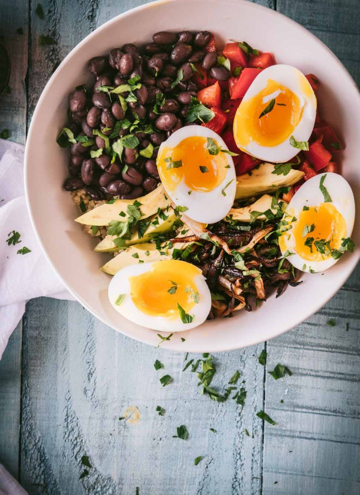 quinoa topped with avocados, black beans, caramelized onions and jammy eggs