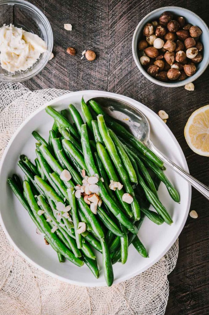 Green beans in a low white dish shot from overhead
