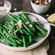 French green beans topped with Hazelnut butter in a low white dish