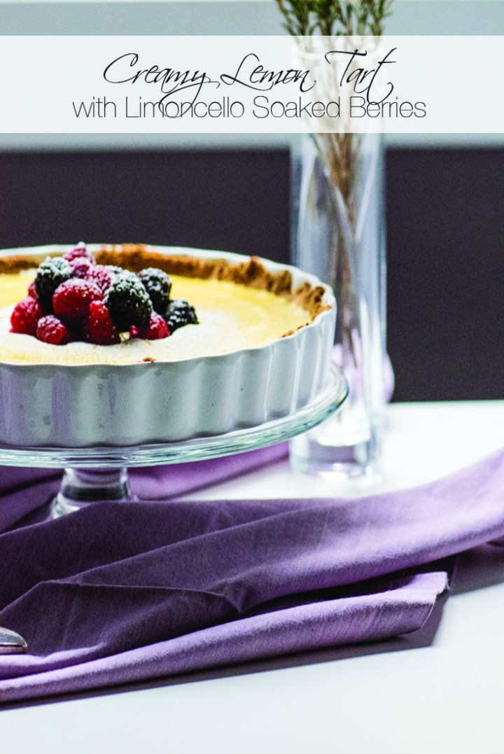 This Creamy Lemon Tart with Shortbread Crust and Limoncello soaked berries is the ultimate spring dessert.