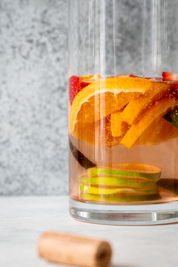 Close up of sangria pitcher filled with sliced fruit