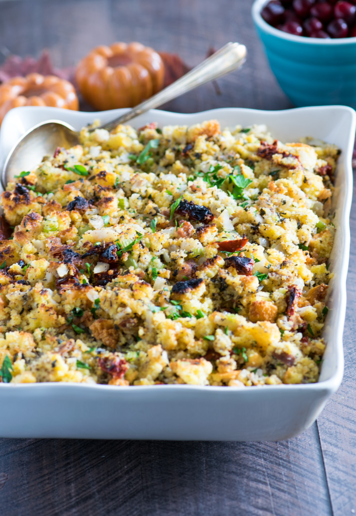Close up of cornbread stuffing in a white serving dish