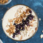 Peach Protein Smoothie Bowl topped with toasted almonds, granola and blueberries