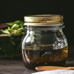 Small mason jar of homemade balsamic vinaigrette dressing