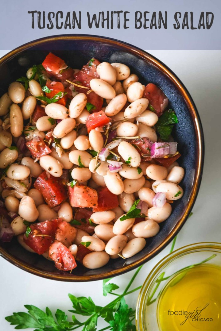 This Tuscan White Bean salad is a super simple summer side dish that uses ingredients you probably already have on hand in your kitchen.  It's a great option for hot summer days when you don't want to cook!