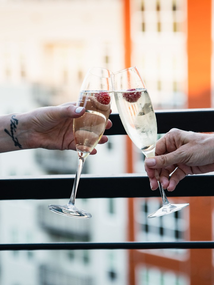 Cheers with two flutes of prosecco