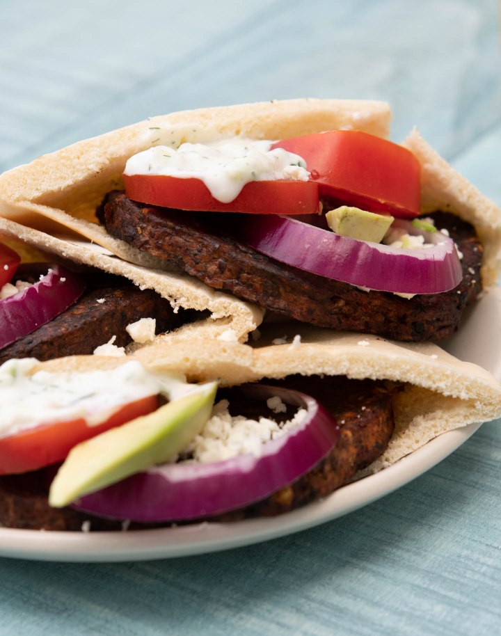 Close-up of Greek-inspired veggie burgers in pita pockets