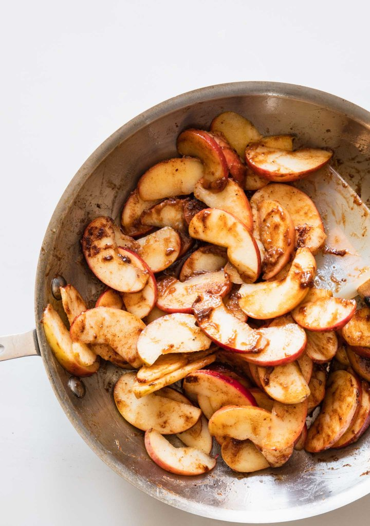 Sauteed apples in skillet for apple crisp
