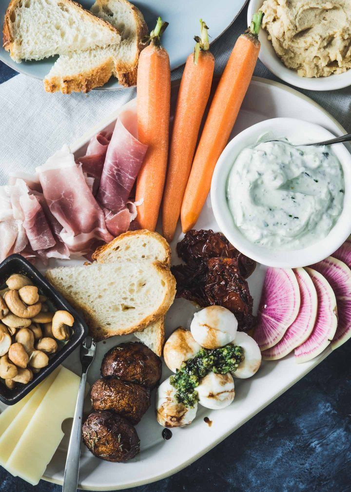 Platter with meat, cheese, veggies and toasted bread