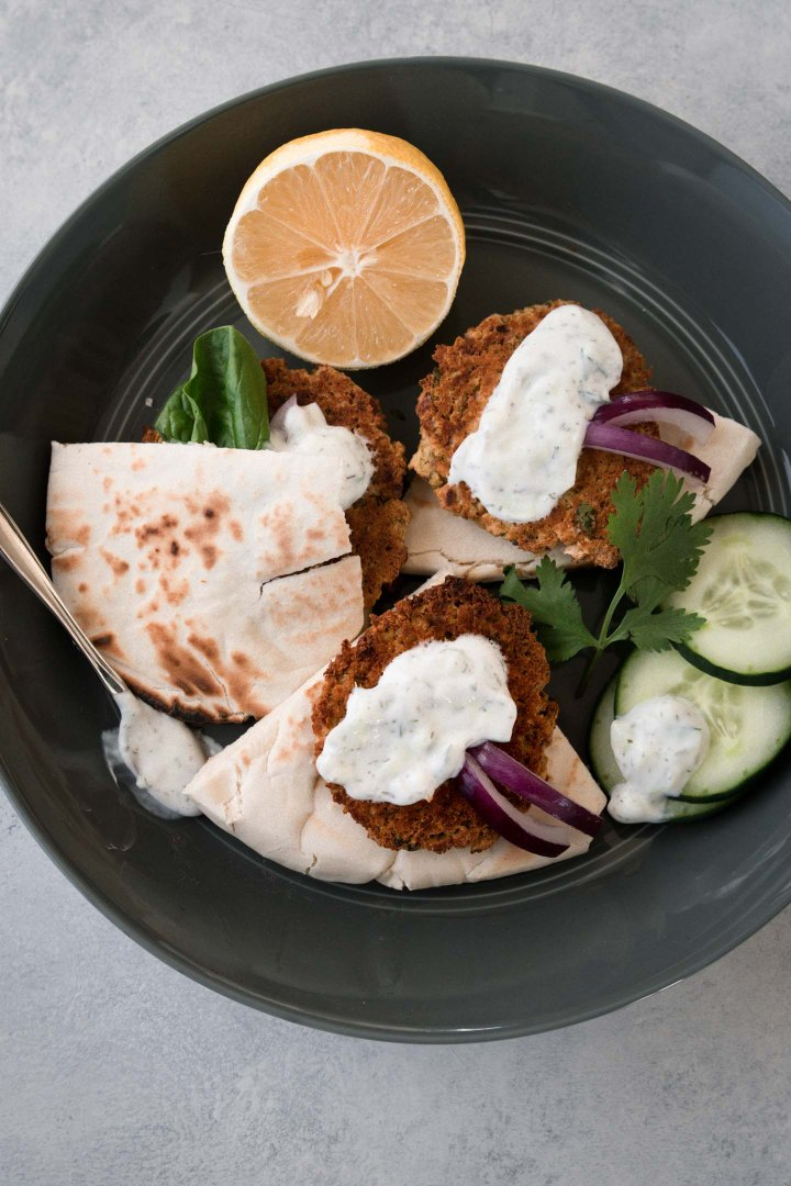 Baked falafel patties with pita bread topped with sauce