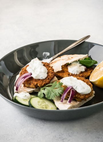 Baked falafel on toasted pita wedges topped with sauce