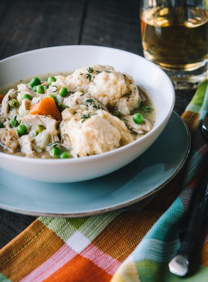 Bowl of Chicken & Dumplings soup on a plaid napkin