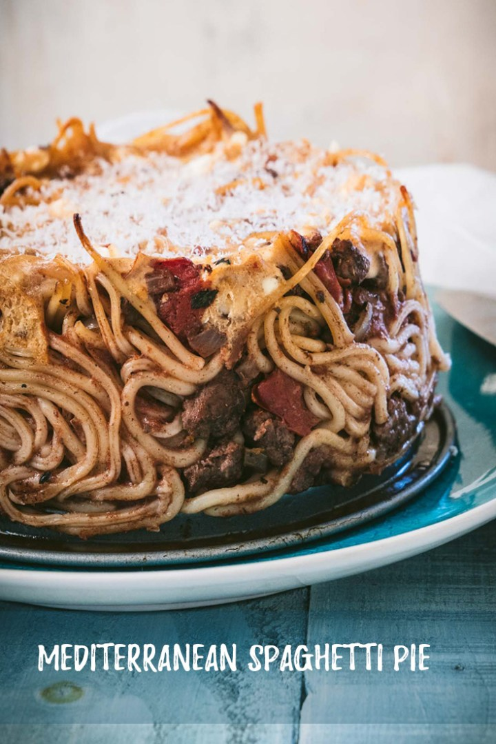This retro baked spaghetti pie gets a dash of Mediterranean flavor for a fun twist on a traditional dish that makes a great easy weeknight meal for two!