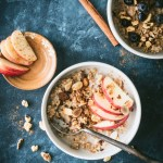 Instant Pot steel cut oats topped with apple slices, nuts and maple syrup